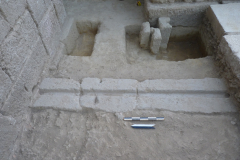 View of three parallel stone grooves for the accommodation of the wheels of the movable stage.